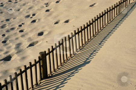 Fence stock photo, Fence in the sand at the portuguese beach by Rui Vale de Sousa