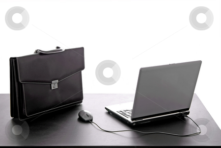 Work stock photo, Laptop and a suitcase on a office desk by Rui Vale de Sousa