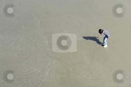 Child stock photo, Young female girl playing at the wet sand by Rui Vale de Sousa