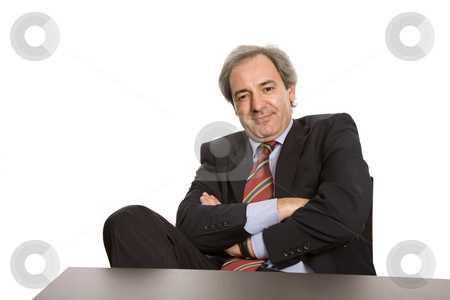Worker stock photo, Mature business man on a desk, isolated on white by Rui Vale de Sousa