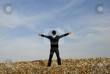 Open arms stock photo, Man with arms wide open at the beach by Rui Vale de Sousa