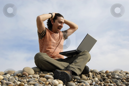 Beach stock photo, Young casual man with laptop at the beach by Rui Vale de Sousa