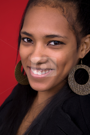 Laugh stock photo, Young beautiful woman closeup portrait, on a red background by Rui Vale de Sousa