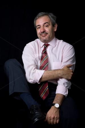 Smile stock photo, Mature business man portrait on black background by Rui Vale de Sousa