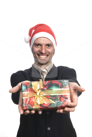 Gift stock photo, Business man with santa hat, with a present by Rui Vale de Sousa