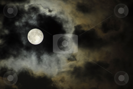 Moon stock photo, Big moon over the clouds in a dark night by Rui Vale de Sousa