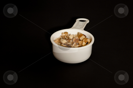 Cup of walnuts stock photo, The nuts of all the species are edible, but the walnuts commonly available in shops are from the common walnut, the only species which has a large nut and thin shell. by Mariusz Jurgielewicz