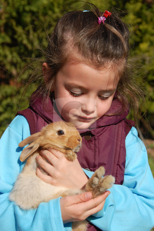 Little girl and bunny stock photo, Little girl and her best friend young bunny by Bonzami Emmanuelle