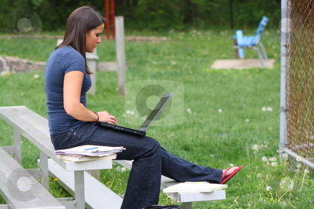 College student studying outdoors stock photo, Girl studying outside at a park. by Chris Torres