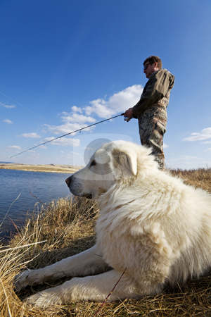 Fishing pet stock photo, A man and his dog enjoying a day together at the lake by Steve Mcsweeny
