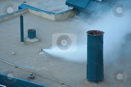 Roof Top Steam Vent stock photo, A small pipe on a building roof blowing off excess steam by Lynn Bendickson