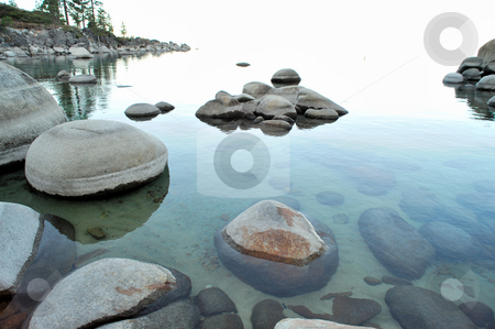 Crystal Clear Lake stock photo, Small bay at Lake Tahoe with rounded granite boulders in the clear water of the lake, back area of photo good for copy space by Lynn Bendickson