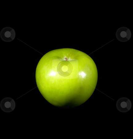 Green apple stock photo, Fresh vivid green apple over black background by Francesco Perre