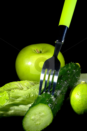 Green stuff stock photo, Group of green vegetables and fruits with fork over black background by Francesco Perre
