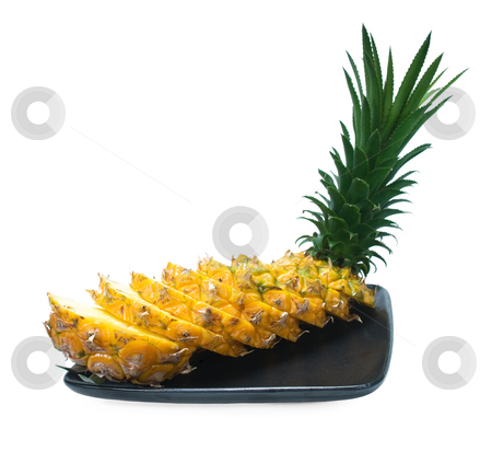 Pineapple stock photo, Pineapple sliced on a black plate isolated on white background by Francesco Perre