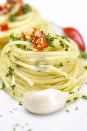 Pasta garlic extra virgin olive oil and red chili pepper stock photo, Pasta garlic olive oil and red chili pepper closeup on a white dish by Francesco Perre