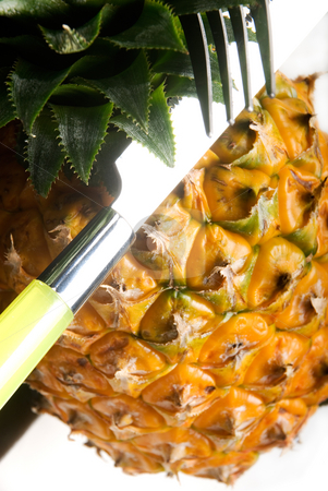 Pineapple stock photo, Ripe pineapple on a black plate with knife and fork by Francesco Perre