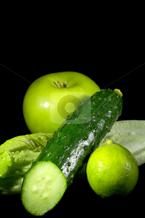 Green stuff stock photo, Group of green vegetables and fruits over black background by Francesco Perre