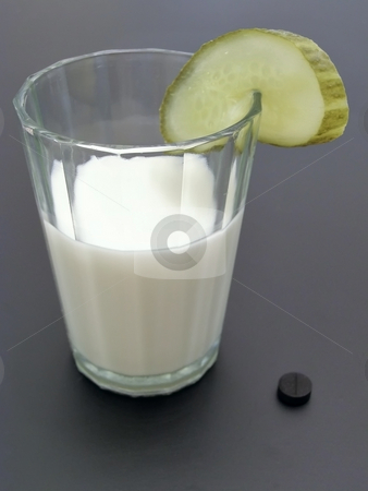 Extraordinary milk coctail stock photo, Glass of milk with piece of cucumber and activated carbon near it by Sergej Razvodovskij