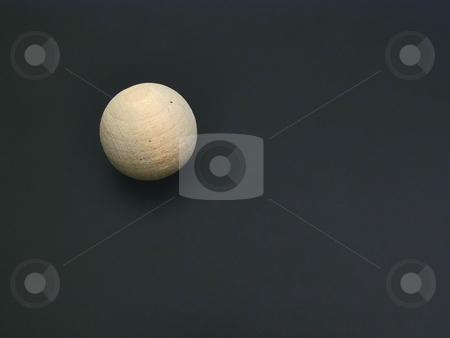 Wooden sphere stock photo, Single wooden sphere over the black background by Sergej Razvodovskij
