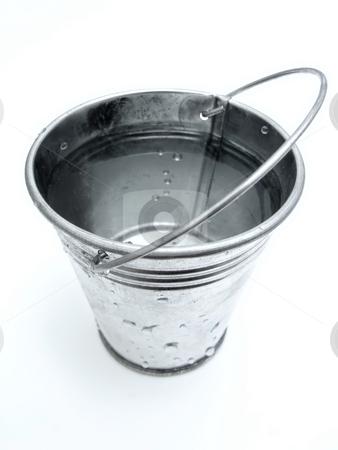 Bucket of water stock photo, The metallic bucket full of water by Sergej Razvodovskij