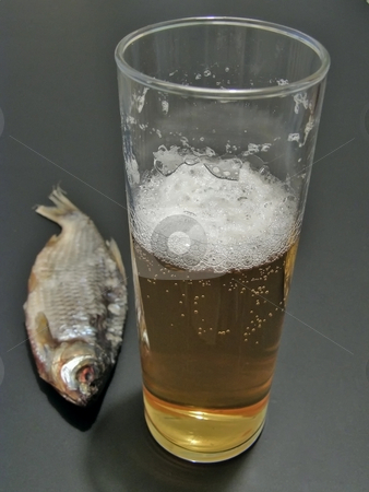 Beer and fish stock photo, Dry fish near the glass of beer by Sergej Razvodovskij