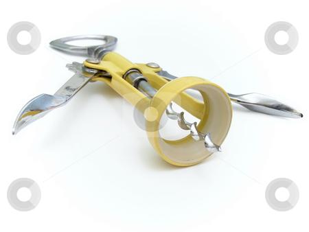 Single corkscrew stock photo, Single metal yellow corkscrew against the white background by Sergej Razvodovskij