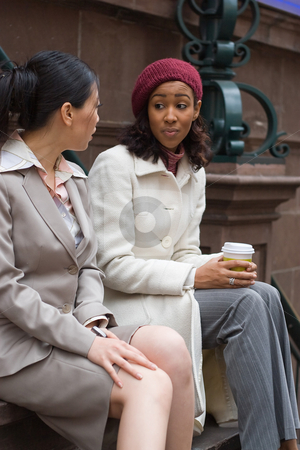 Happy Business Women stock photo, Two business women having a casual meeting or discussion in the city. Shallow depth of field. by Todd Arena