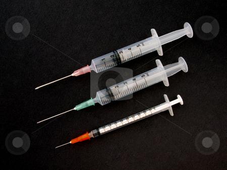 Hypodermic syringe and needle stock photo, Hypodermic syringe and needle used for immunization. by Ian Langley