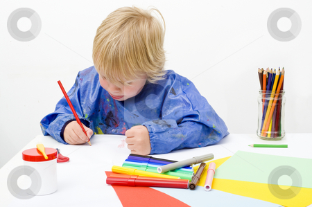 Coloring stock photo, Young artist making a drawing, using pencils, felt pens, glue, scissors and paper by Corepics VOF