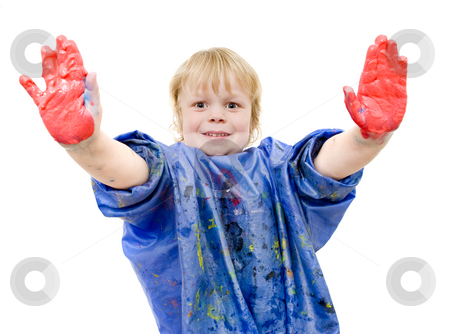 Finger painting stock photo, Young boy holding up his in red acrylic finger paint covered hands and smiling happily by Corepics VOF