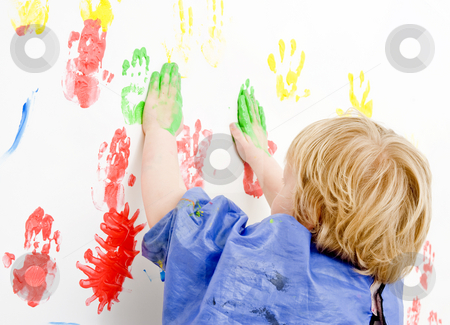 Finger paingint stock photo, Young boy finger painting on a wall by Corepics VOF