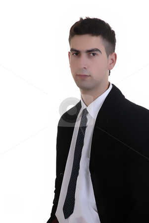 Serious stock photo, Young serious man standing in a white background by Rui Vale de Sousa