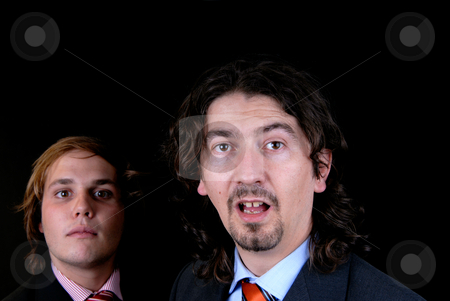 Stupid stock photo, Business man portrait isolated on black background, focus on the right man by Rui Vale de Sousa