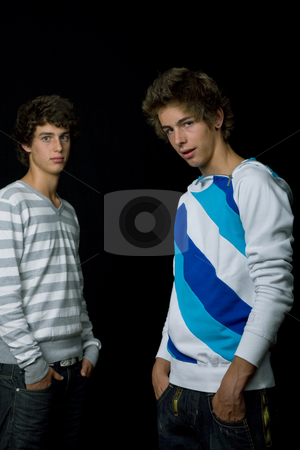 Young men stock photo, Two young men standing, on a black background by Rui Vale de Sousa