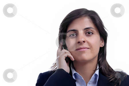 Woman on cellphone stock photo, Young business woman on the phone isolated on white by Rui Vale de Sousa