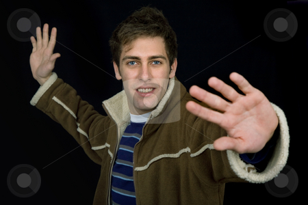 Stop stock photo, Young casual man against a black background by Rui Vale de Sousa