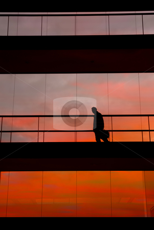 Interior stock photo, Business man inside the modern building at sunset by Rui Vale de Sousa