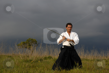 Fight stock photo, Young aikido man with a sword outdoors by Rui Vale de Sousa