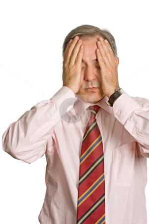 Headache stock photo, Businessman in a suit gestures with a headache by Rui Vale de Sousa