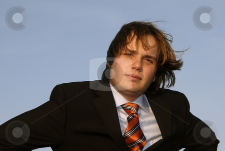 Stand stock photo, Portrait of a young business man, on blue sky by Rui Vale de Sousa