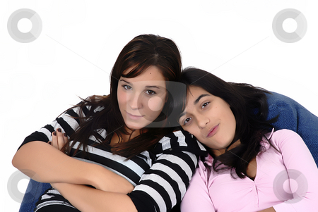Girls stock photo, Two young girls in a sofa isolated in white by Rui Vale de Sousa