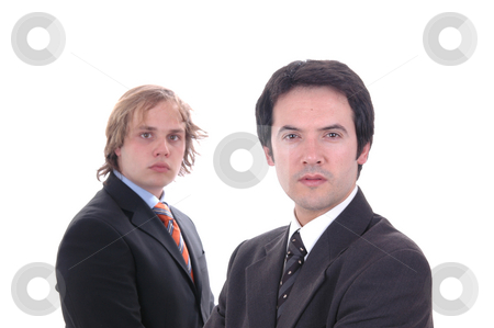 Team stock photo, Two young business men portrait on white. focus on the right man by Rui Vale de Sousa