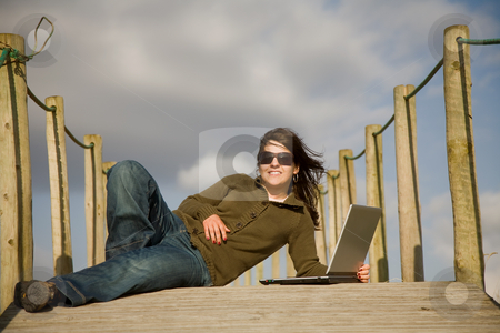 Relax stock photo, Young woman working with computer at the beach by Rui Vale de Sousa