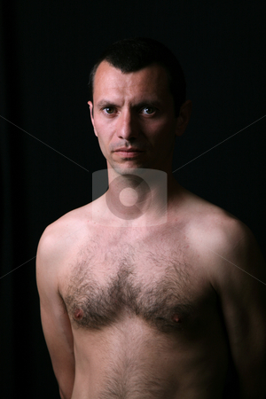 Young man stock photo, Young man model on a black background by Rui Vale de Sousa