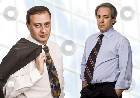 Team stock photo, Two business men portrait standing in front of a modern building by Rui Vale de Sousa