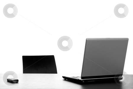 Laptop stock photo, Silver laptop with mouse on a office desk by Rui Vale de Sousa