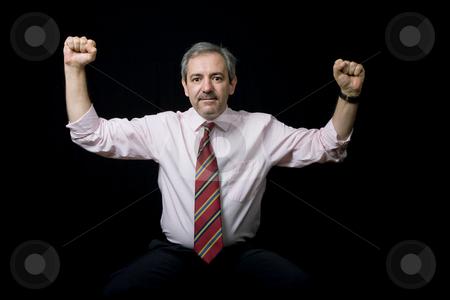 Victory stock photo, Mature business man portrait on black background by Rui Vale de Sousa
