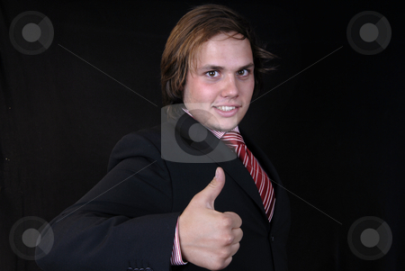 Thumb up stock photo, Young business man showing thumb up on black background by Rui Vale de Sousa