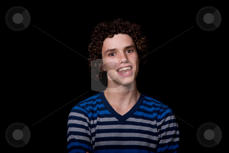 Happy stock photo, Young happy man portrait, on a black background by Rui Vale de Sousa